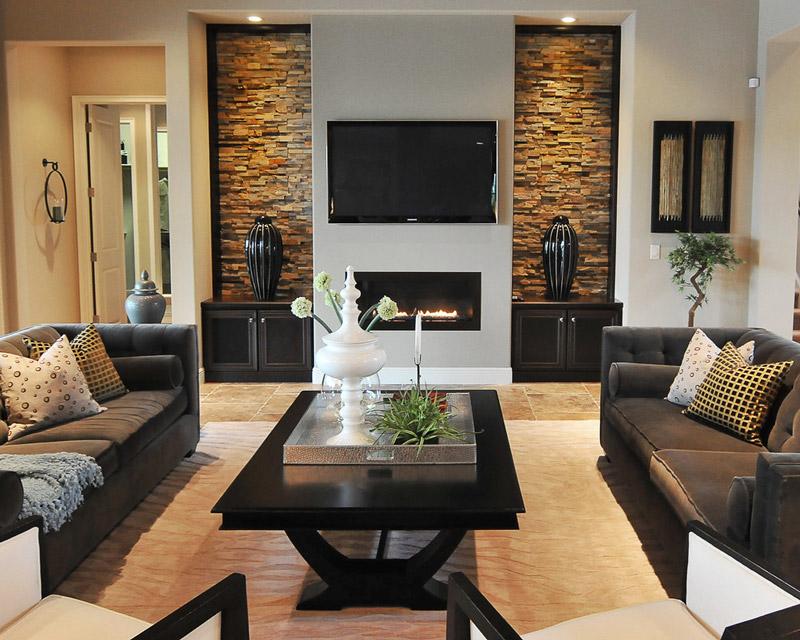 decoração sala moderna com pedras na parede